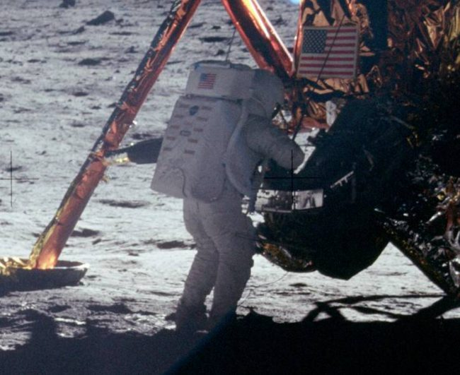Neil Armstrong works at the LM in the only photo taken of him on the moon from the surface