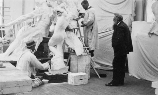 Rodin observing work on the monument to Victor Hugo at the studio of his assistant Henri Lebossé in 1896