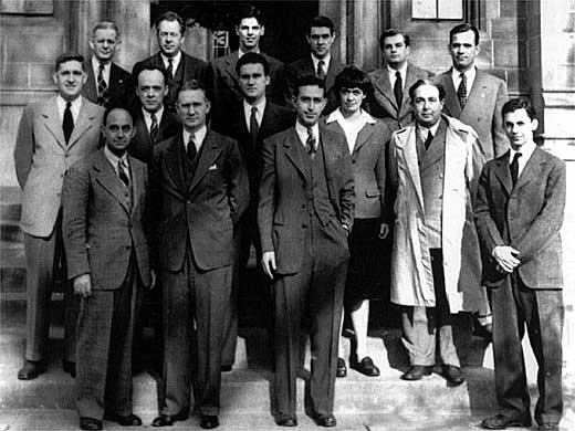 Chicago Pile One scientists at the University of Chicago on December 2, 1946, the fourth anniversary of their success. Back row, from left: Norman Hilberry, Samuel Allison, Thomas Brill, Robert Nobles, Warren Nyer, and Marvin Wilkening. Middle row: Harold Agnew, William Sturm, Harold Lichtenberger, Leona Woods and Leó Szilárd. Front row: Enrico Fermi, Walter Zinn, Albert Wattenberg and Herbert L. Anderson.