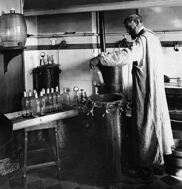 Louis Pasteur performing an experiment.
