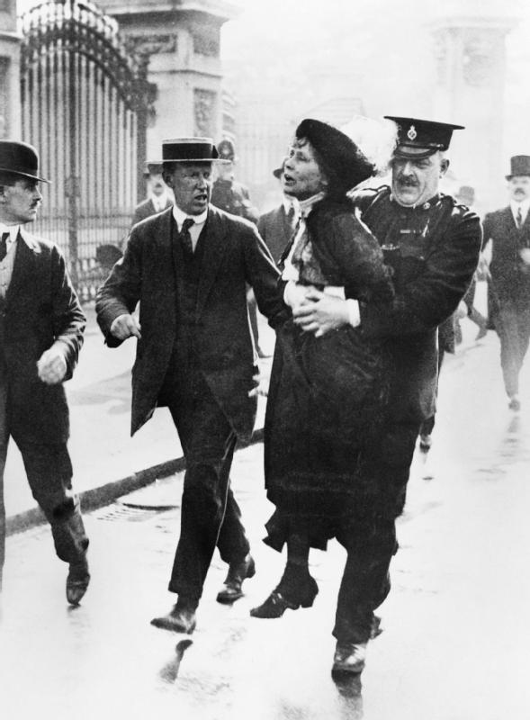 Emmeline Pankhurst is arrested by police outside Buckingham Palace, in May 1914