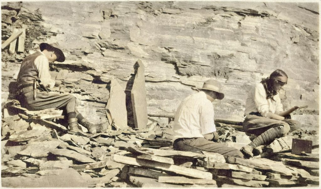 In 1909, while in the Canadian Rockies near Field, British Columbia, Charles Doolittle Walcott (1850-1927) discovered what has come to be known as the Burgess Shale. Named after Burgess Pass near the location of his discovery, the shale Walcott collected contained carbonized organisms of such abundance and age that they subsequently provided the foundation for study of the Cambrian Period in Western North America. Walcott, fourth Secretary of the Smithsonian, often took his entire family on collecting trips. According to the Smithsonian institution, this image shows Walcott, his son Sidney Stevens Walcott (1892-1977), and his daughter Helen Breese Walcott (1894-1965) working in the Burgess Shale Fossil Quarry, c. 1913.
