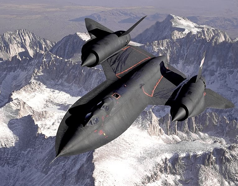 The SR-71B Blackbird, flown by the Dryden Flight Research Center as NASA 831 slices across the snow-covered southern Sierra Nevada Mountains of California