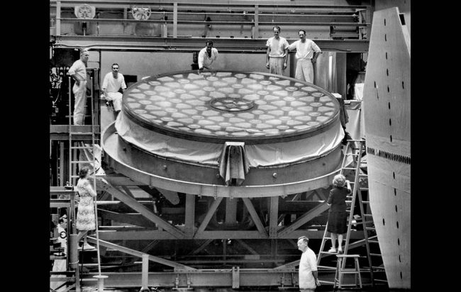 Dec. 3, 1945: Workers pose with the mirror of the 200-inch telescope at the Caltech Optical Shop in Pasadena when grinding work was resumed following the end of World War II. Work was halted in 1942. The mirror was transportedd to Palomar Observatory in 1947.