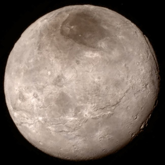 Remarkable new details of Pluto's largest moon Charon are revealed in this image from New Horizons' Long Range Reconnaissance Imager (LORRI), taken late on July 13, 2015 from a distance of 289,000 miles (466,000 kilometers). A swath of cliffs and troughs stretches about 600 miles (1,000 kilometers) from left to right, suggesting widespread fracturing of Charon's crust, likely a result of internal processes.