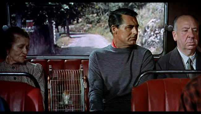 Cameo appearance of Hitchcock next to Cary Grant in his To Catch a Thief