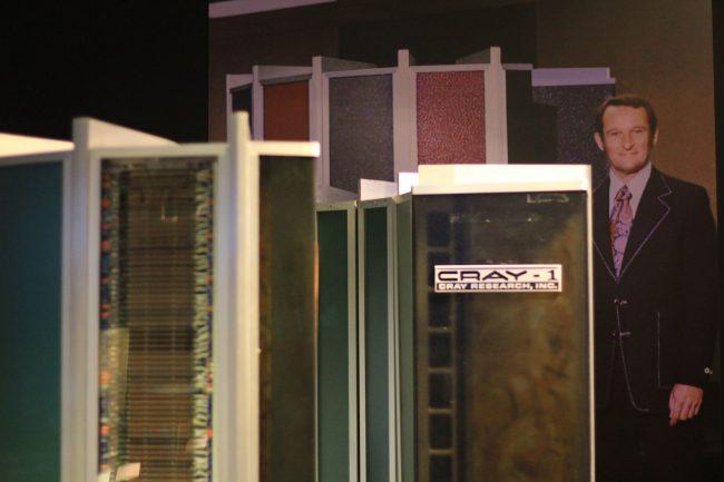 Seymour Cray peeking out behind a Cray-1.