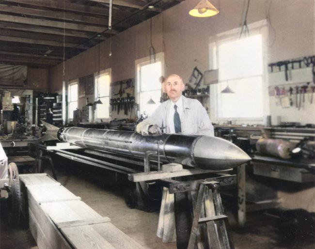 Goddard with a rocket in his workshop at Roswell, NM. October 1935.