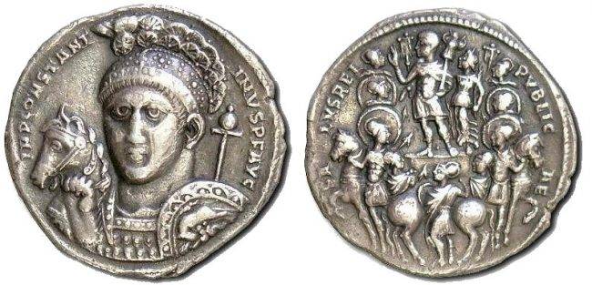 Portrait of Constantine on the front of a silver medallion, stamped 313 in Ticinum (Pavia), with Christ monogram on the helmet bush