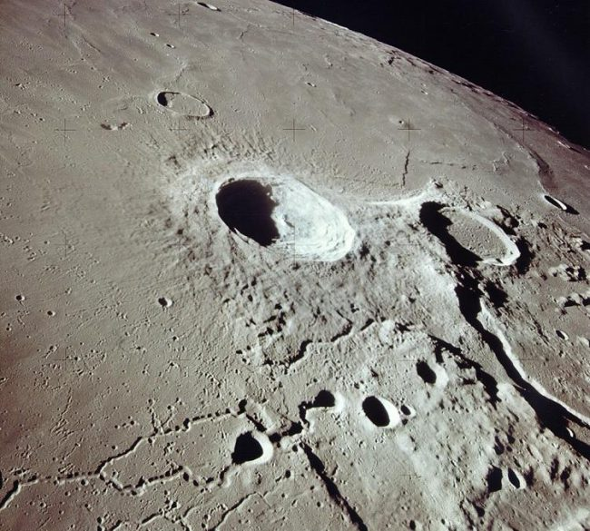This is a view of the Aristarchus and Herodotus craters taken from orbit during the Apollo 15 mission. The view is toward the south. Aristarchus crater is near the center of the image, and the flooded Herodotus is to the right.