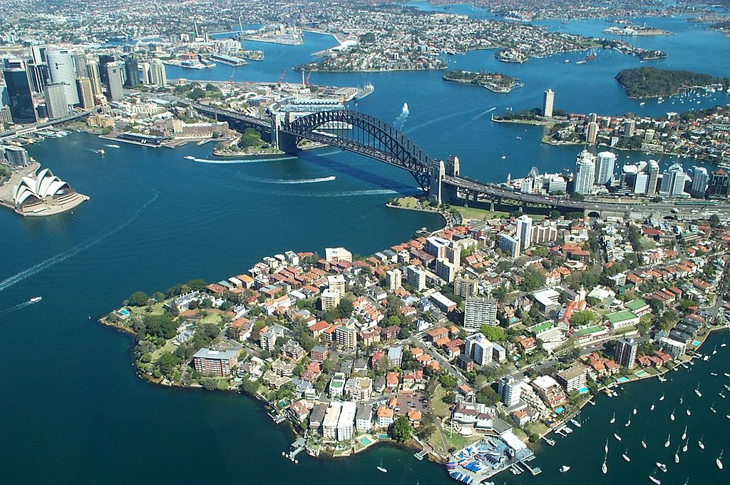 Sydney Harbour Bridge shot taken from the air. Bridge with the Opera house to the side Image: Rodney Haywood