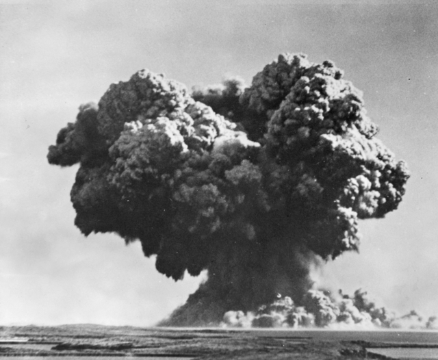 Monte Bello Islands, WA, 1952-10-03. Britain's first atomic weapon is detonated at 0800 hours. An early stage in the explosion after the initial orange flash had been enveloped by the great uprush of water. Immense clouds of smoke, steam and spray burst into the air.