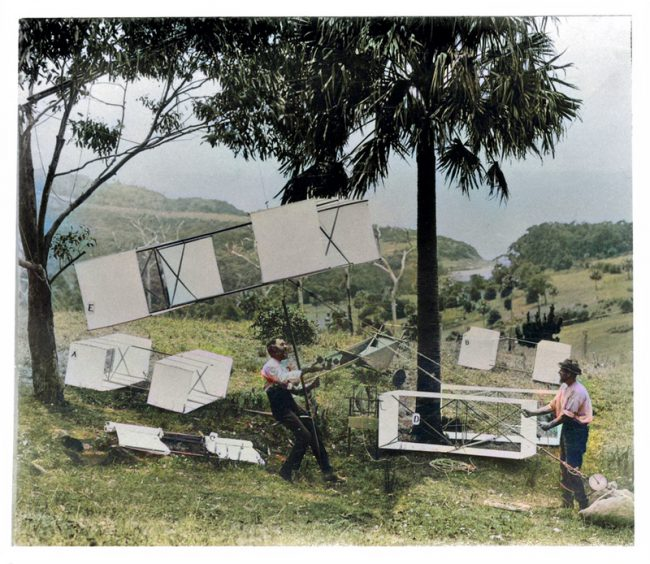 Hargrave (seated) and Swain demonstrate the manlift kites
