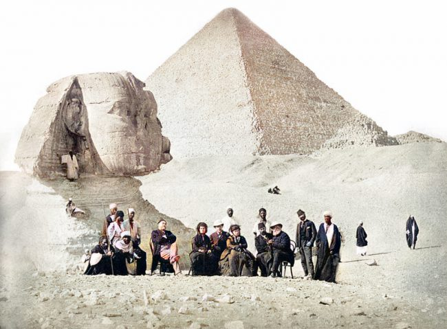 The Sphinx with Auguste Mariette (seated, far left) during the visit of Pedro II of Brazil to the Giza Necropolis at the end of 1871.