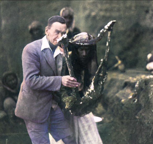 Sir Leonard Woolley holding the noted excavated Sumerian Queen's Lyre, 1922
