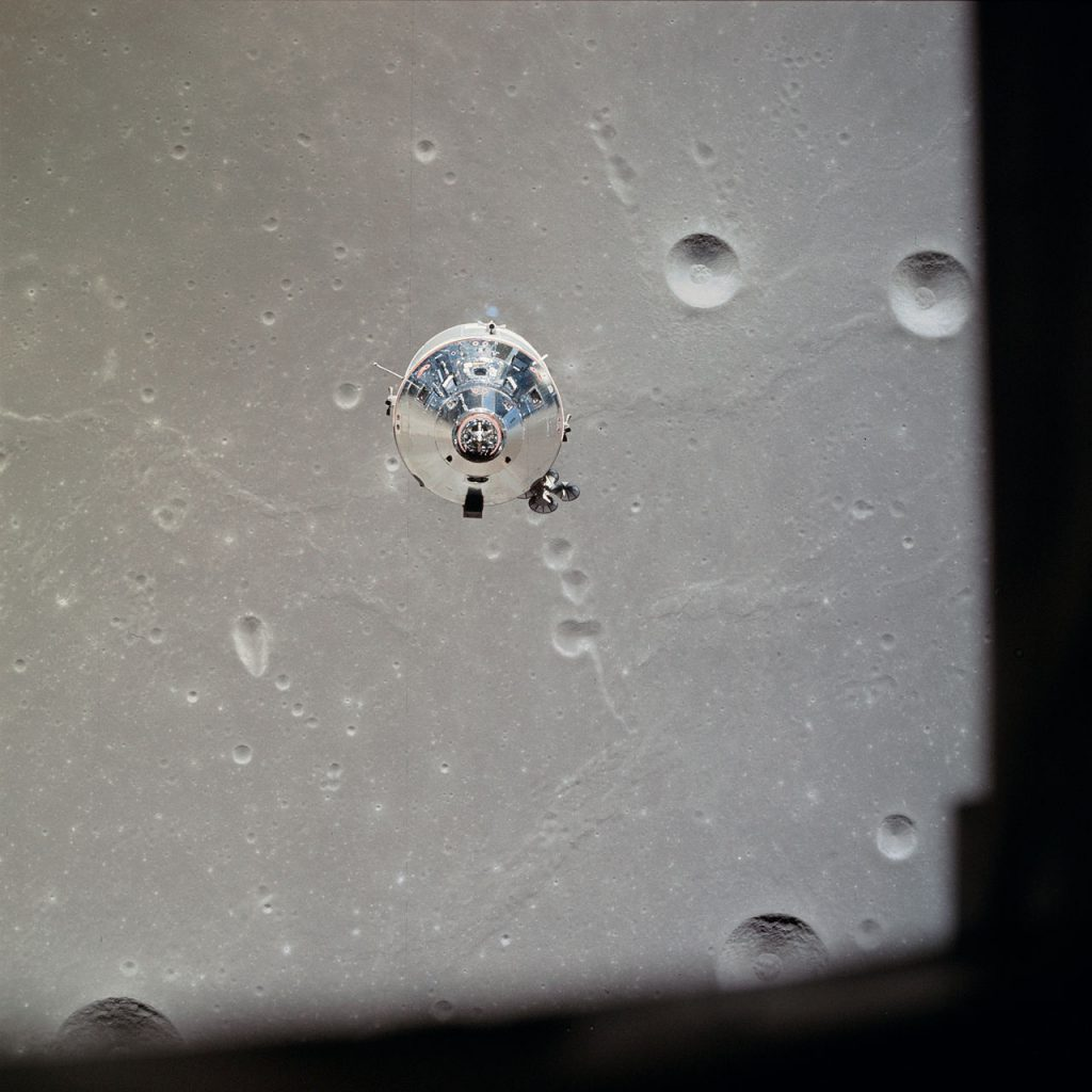 Columbia in lunar orbit and piloted by Collins alone, photographed from Eagle