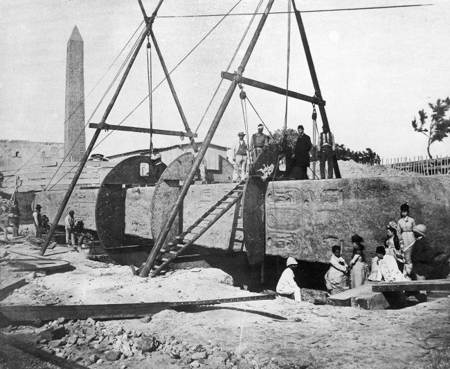 Cleopatra's Needle: construction of the cylinder around the Needle for transport to London.
