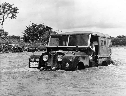 Land Rover Series 1 Half submerged in rapid-moving water