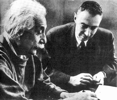 Physicists Albert Einstein and Oppenheimer conferring circa 1950