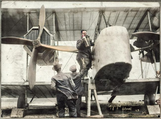 Captain John Alcock stowing provisions aboard Vickers Vimy aircraft before trans-Atlantic flight 14 Jun 1919