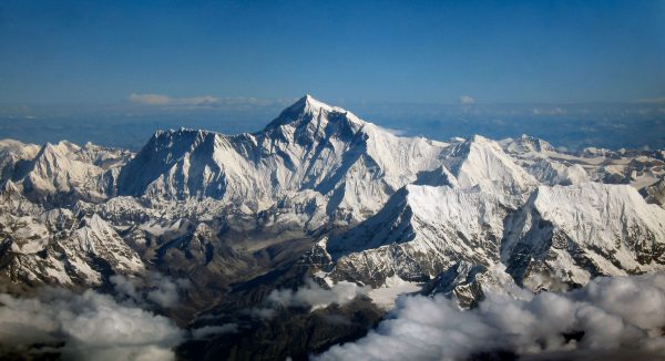 Aerial photo from the south, with Mount Everest rising above the ridge connecting Nuptse and Lhotse, By Mount_Everest_as_seen_from_Drukair2.jpg: shrimpo1967 derivative work: Papa Lima Whiskey 2 [CC BY-SA 2.0 (http://creativecommons.org/licenses/by-sa/2.0)], via Wikimedia Commons