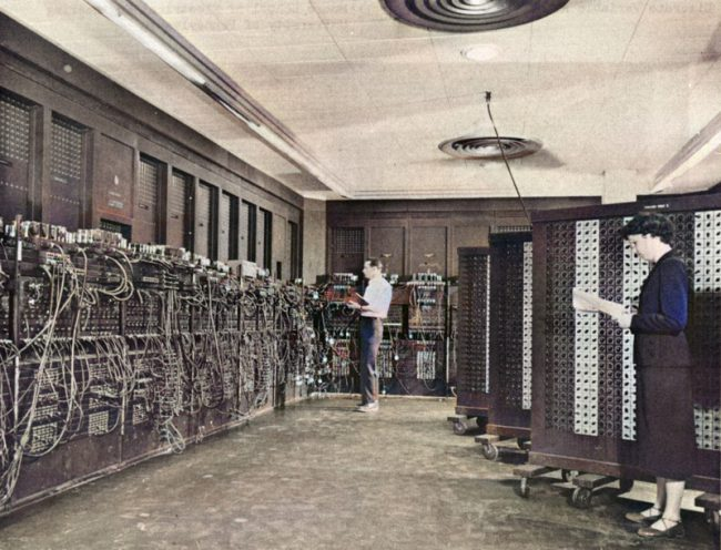 ENIAC on a picture of the US Army, Betty Holberton in the foreground, Glen Beck in the background Unknown - U.S. Army Photo