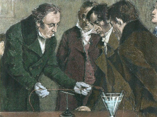 Oersted discovers electromagnetism in 1820. Engraving with later colouration.
