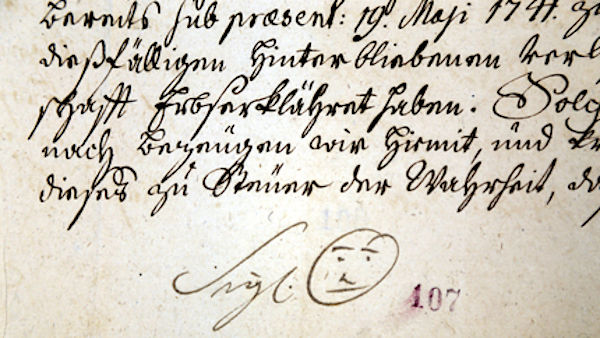 Signature of Bernard Hennet, abbot of the Cistercian monastery Žďár from 1741 with a smiley-like drawing