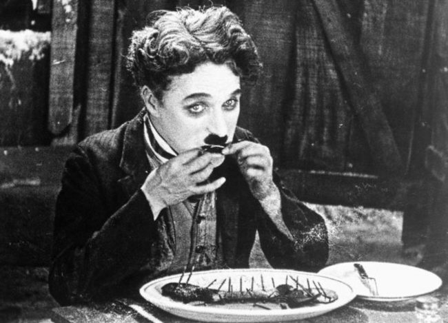 Cropped publicity still for Charlie Chaplin's 1925 film The Gold Rush.