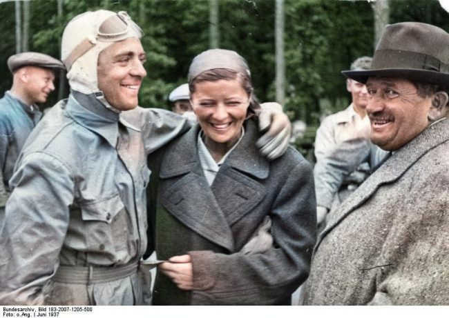 Elly Beinhorn (center) with Bernd Rosemeyer and Ferdinand Porsche