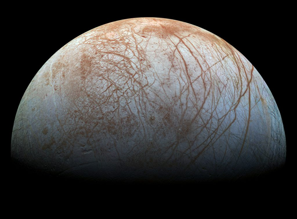 The puzzling, fascinating surface of Jupiter's icy moon Europa looms large in this newly-reprocessed color view, made from images taken by NASA's Galileo spacecraft
