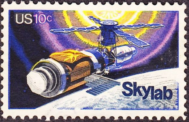 SkyLab commemorative stamp, Issue of 1974. The commemorative stamp reflects initial repairs to the station, including the parasol sunshade.